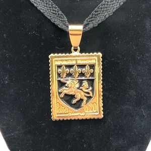 JOAN RIVERS GOLD TONE POSTAGE STAMP PENDANT